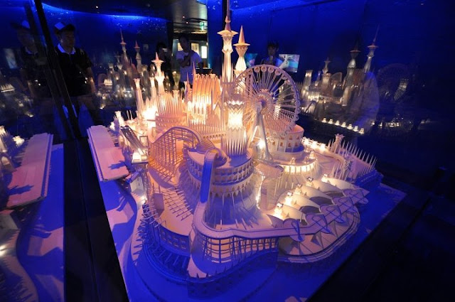intricate paper castle sculpture