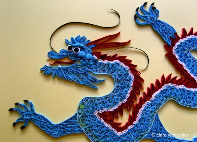 quilled blue and red dragon