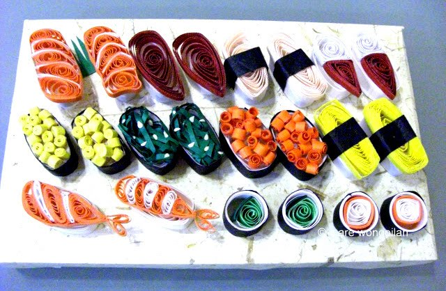 quilled sushi on tray