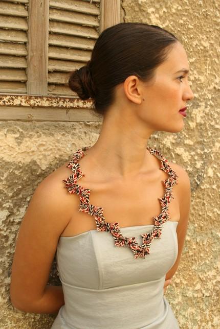 folded paper necklace on model