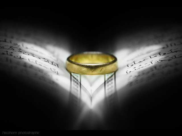 gold ring on AlQuran with love light