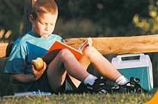 NAMC montessori language arts summer time boy reading