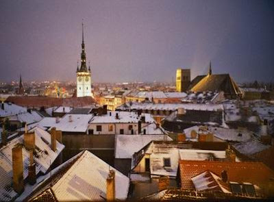 Olomouc rooftops and church towers under a dusting of snow