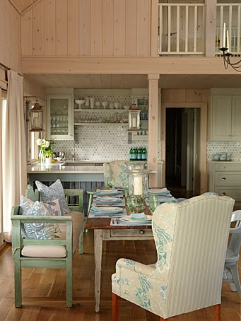 Charming blue and green dining area and kitchen in pine paneled cottage by Sarah Richardson