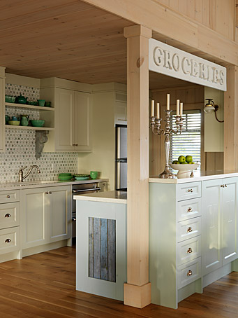 Cottage style kitchen with charming vintage style Groceries sign and pine paneling