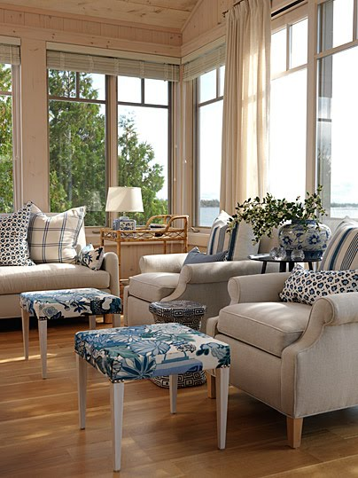 Blue and white decor in a lakeside sun room with pine paneling