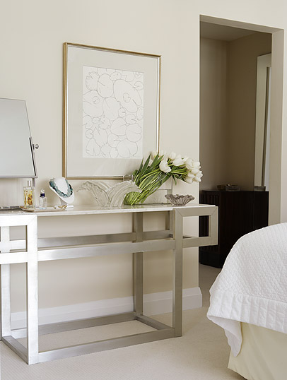 Modern console in a serene bedroom by Sarah Richardson