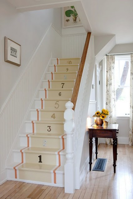 Whimsical painted stair runners with numbers in farmhouse with beadboard on Hello Lovely Studio