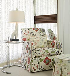 Cheerful colorful fabric on armchair and Giraffe lamp