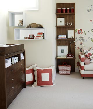 Nursery with cheerful floral fabrics by Sarah Richardson