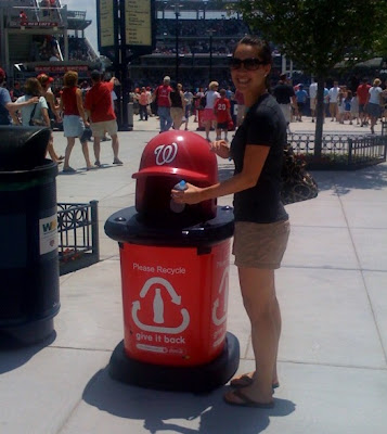 The Twin demonstrates how to recycle at Nats Field