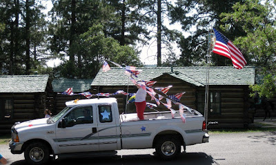 Post mistress in truck 4th of July parade North Rim Grand Canyon National Park Arizona