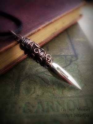 Poet.  Antique fountain pen nib wire wrapped