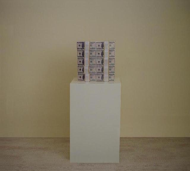 "Klaus Guingand artwork: IN GOD WE TRUST / ""$ One Million cash""  1999. Digital prints on paper, plastic vacuum. 12,9 x 4,3 x 12,2 inches - 22 livres 33 cm x 12 cm X 31,1 cm - 10 Kg Dollart TM © Klaus Guingand"