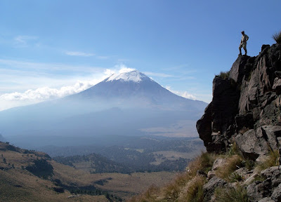 Peregrine enthusiast surveys the view across to Popocatepetl, Mexico.