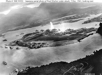 ord Island during early attack. Battleship Row is visible, as is a Jap plane.