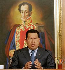 Venezuelan President-for-Life Hugo Chávez posing (again) in front of portrait of Simón Bolívar
