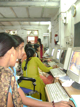 young girls in Delhi SEWA learn design on computers