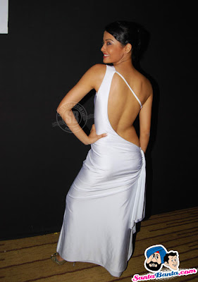 Surveen Chawla wearing Hot White Backless Dress in IIJW-2010