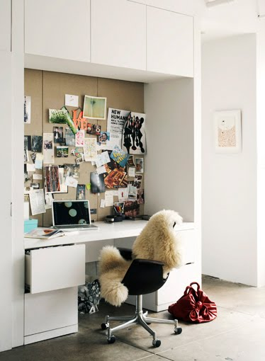 White modern home office with built in cabinets and drawers