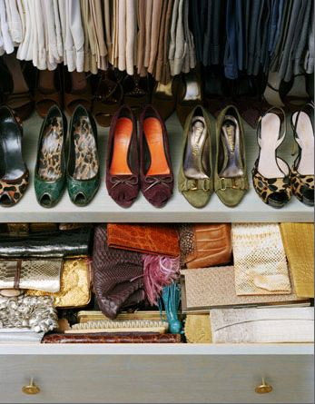 Close up of a shoe rack in a well organized closet and a slightly opened drawer showing how wallets and clutch purses are organized