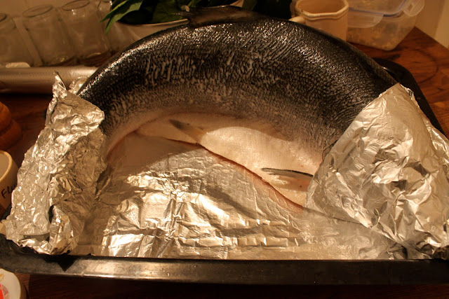 I positioned the fish in the 'swimming position', that is, on it's stomach...cover head and tail in foil