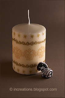 Decoupage candle with a star pattern