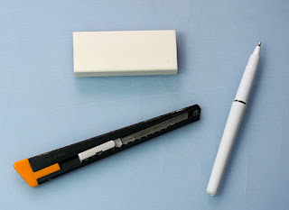 Pen, eraser and knife
