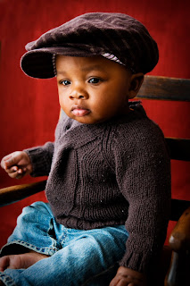Infant baby boy in matching sweater and hat