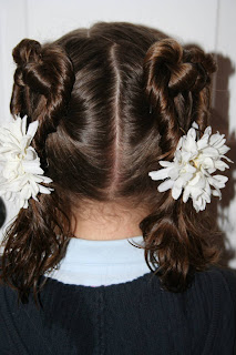 Back view of Two Heart Twists hairstyle