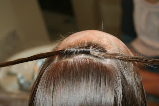 "Close up of Girl's hair being styled into ""Double Knot Ponytail"""