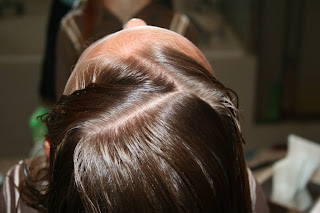 "Top view of girl's hair being styled into ""Zig-Zag Part"""