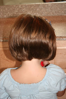 Back view of young girl with  A-Line Bob Haircut