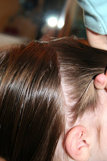 """Side view of young girl's hair being styled into """"Two Messy Twists on Top"""" Hairstyle"""
