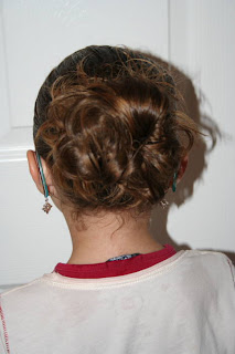 "Back view of young girl modeling ""Hair Twists into Messy Buns"" hairstyle"