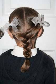 "Back view of young girl modeling ""Y"" braid hairstyle"