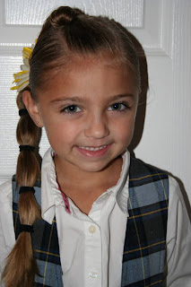 "Portrait of young girl modeling ""Top-Knot with Banded"" Ponytail"