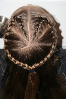 "Top view of a young girl modeling ""French Designer Heart"" hairstyle"