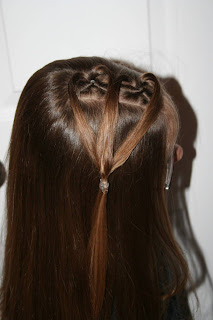 "Side view of young girl modeling ""teen heart"" hairstyle 2"