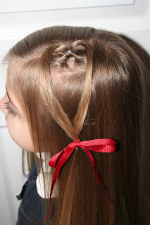 "Side view of young girl modeling ""teen heart"" hairstyle 13"
