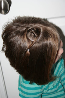 "Top view of young girl modeling ""teen heart"" hairstyle 4"