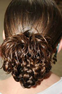 "Back view of young girl modeling ""bundled braids"" hairstyle"
