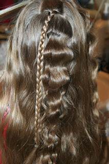 "Back view of young girl's hair being styled into ""Beachy Combo"" hairstyle"