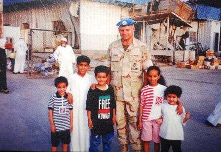 Tom with kids in Kuwait