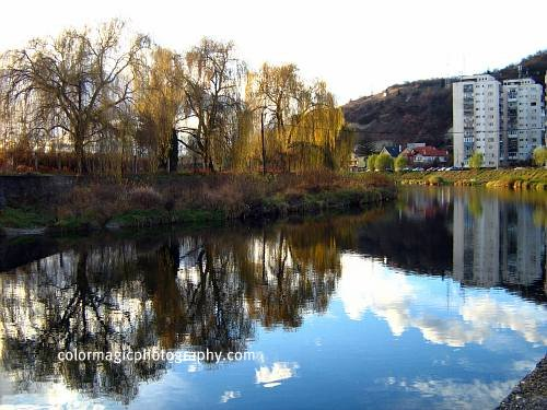 Autumn river scene with reflection