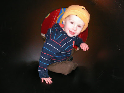 boy in a tunnel, playpark obstacle