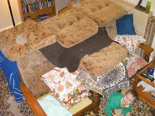den of cushions under sofa