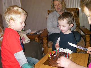 cutting the birthday cake in the lounge, willing participants