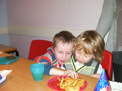 stealing chips at birthday party in soft play kids area