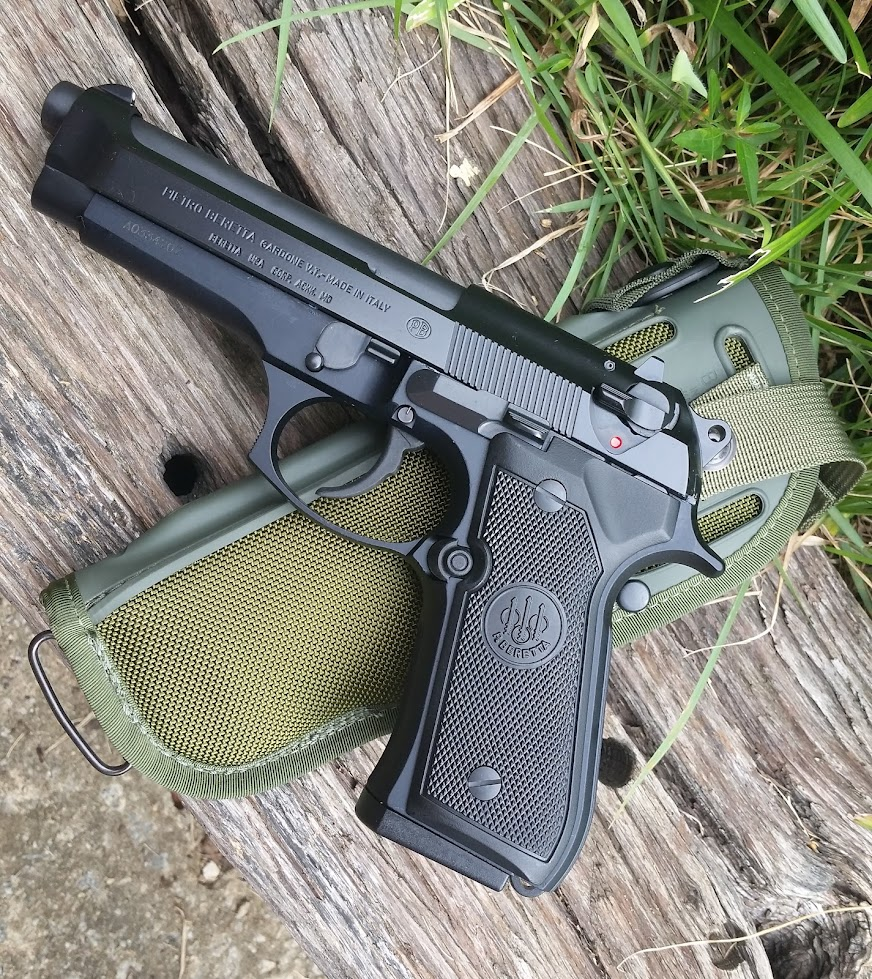 a fine blade the beretta m9 is a great service pistol so get over it
